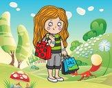 Menina com compras do verão